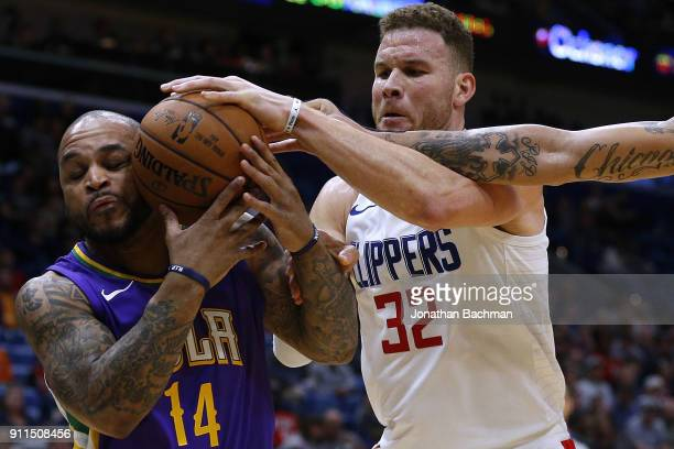 Jameer Nelson of the New Orleans Pelicans and Blake Griffin of the LA Clippers go for a rebound during the second half at the Smoothie King Center on...