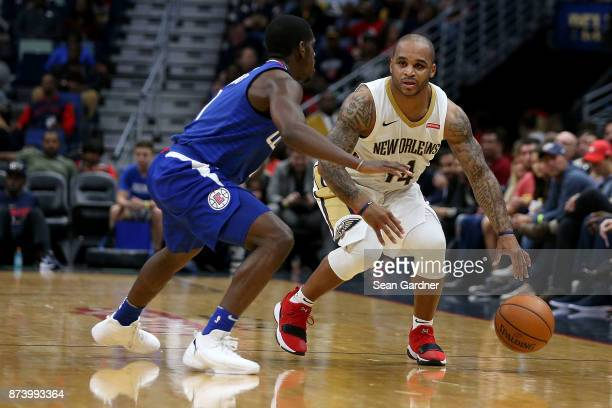 Jameer Nelson of the New Orleans Pelicans is defended by DeAndre Jordan of the LA Clippers during the first half at the Smoothie King Center on...