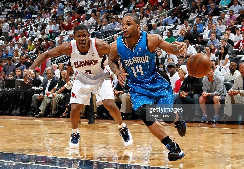 Jameer Nelson #14 of the Orlando Magic against Joe Johnson #2 of the Atlanta Hawks during Game Four of the Eastern Conference Semifinals of the 2010 NBA Playoffs at Philips Arena on May 10, 2010 in Atlanta, Georgia.