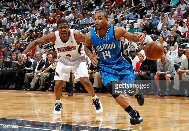 Jameer Nelson of the Orlando Magic against Joe Johnson of the Atlanta Hawks during Game Four of the Eastern Conference Semifinals of the 2010 NBA...