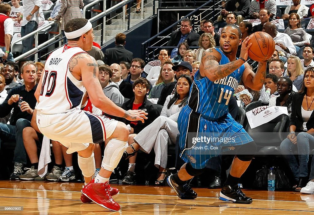 Jameer Nelson #14 of the Orlando Magic against Mike Bibby #10 of the Atlanta Hawks during Game Four of the Eastern Conference Semifinals of the 2010 NBA Playoffs at Philips Arena on May 10, 2010 in Atlanta, Georgia.