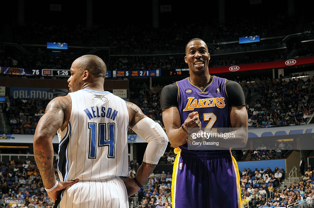 Jameer Nelson #14 of the Orlando Magic and Dwight Howard #12 of the Los Angeles Lakers during the game on March 12, 2013 at Amway Center in Orlando, Florida.
