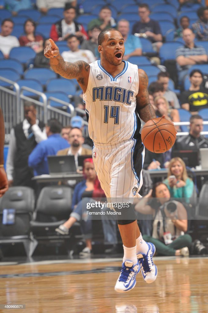 Jameer Nelson #14 of the Orlando Magic dribbles the ball up the court while calling a play against the Miami Heat during the game on November 20, 2013 at Amway Center in Orlando, Florida.