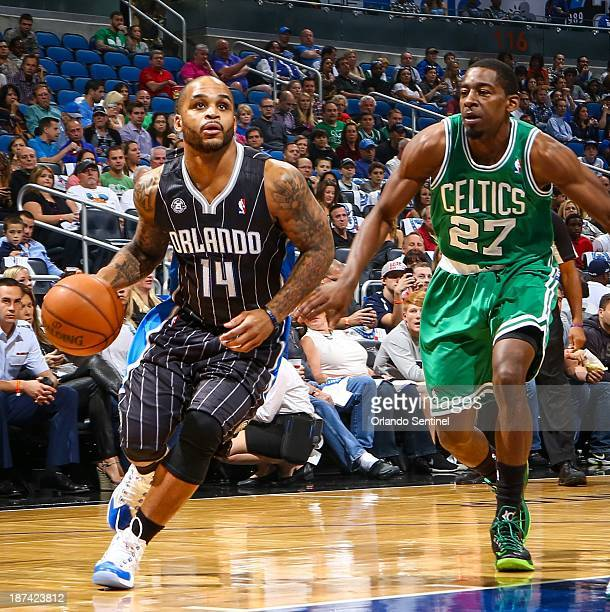 Jameer Nelson of the Orlando Magic drives against Jordan Crawford of the Boston Celtics in the first quarter at Amway Center in Orlando Fla on Friday...