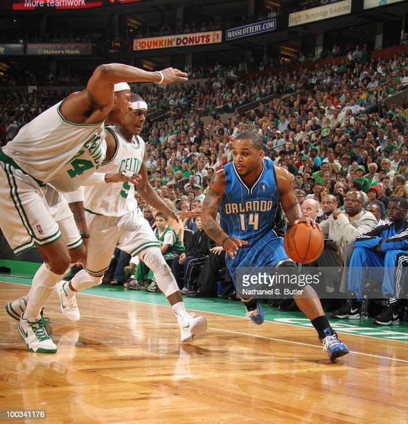Jameer Nelson of the Orlando Magic drives against Paul Pierce and Rajon Rondo of the Boston Celtics in Game Three of the Eastern Conference Finals...