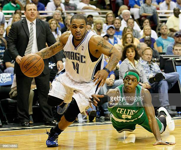 Jameer Nelson of the Orlando Magic drives past Rajon Rondo of the Boston Celtics in Game One of the Eastern Conference Finals during the 2010 NBA...