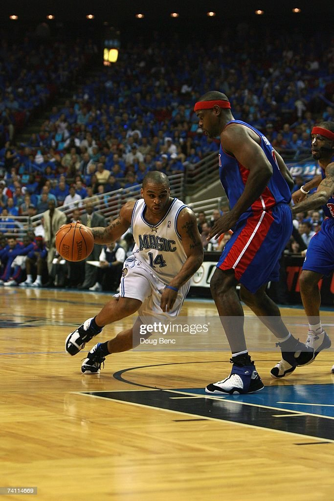 Jameer Nelson #14 of the Orlando Magic drives to the basket against Chris Webber #84 of the Detroit Pistons in Game Three of the Eastern Conference Quarterfinals during the 2007 NBA Playoffs at Amway Arena on April 26, 2007 in Orlando, Florida. The Pistons won 93-77.
