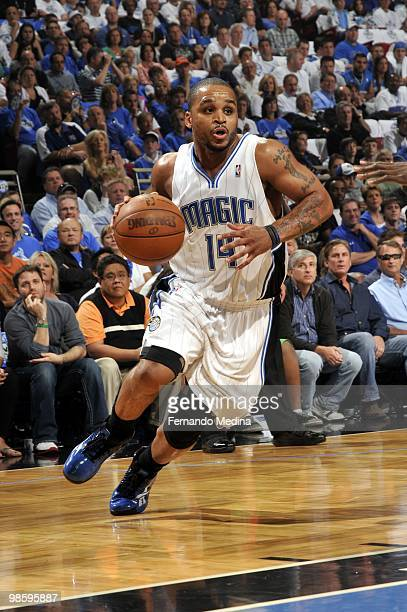 Jameer Nelson of the Orlando Magic drives to the basket against the Charlotte Bobcats in Game One of the Eastern Conference Quarterfinals during the...
