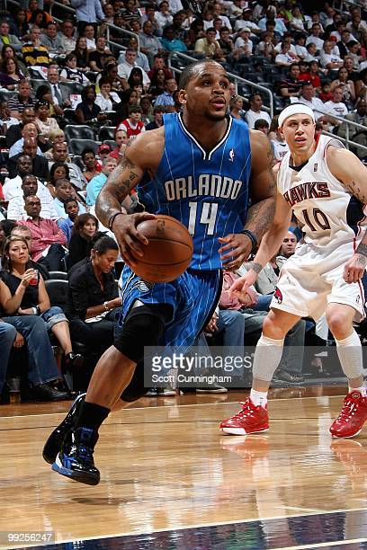 Jameer Nelson of the Orlando Magic drives to the basket past Mike Bibby of the Atlanta Hawks in Game Three of the Eastern Conference Semifinals...