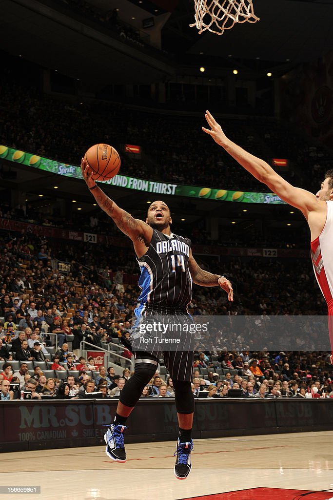 Jameer Nelson #14 of the Orlando Magic goes to the basket vs the Toronto Raptors during the game on November 18, 2012 at the Air Canada Centre in Toronto, Ontario, Canada.