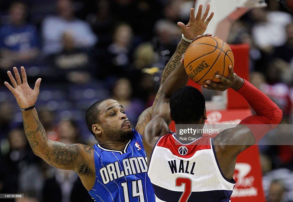 Jameer Nelson #14 of the Orlando Magic guards John Wall #2 of the Washington Wizards during the first half at the Verizon Center on February 29, 2012 in Washington, DC.