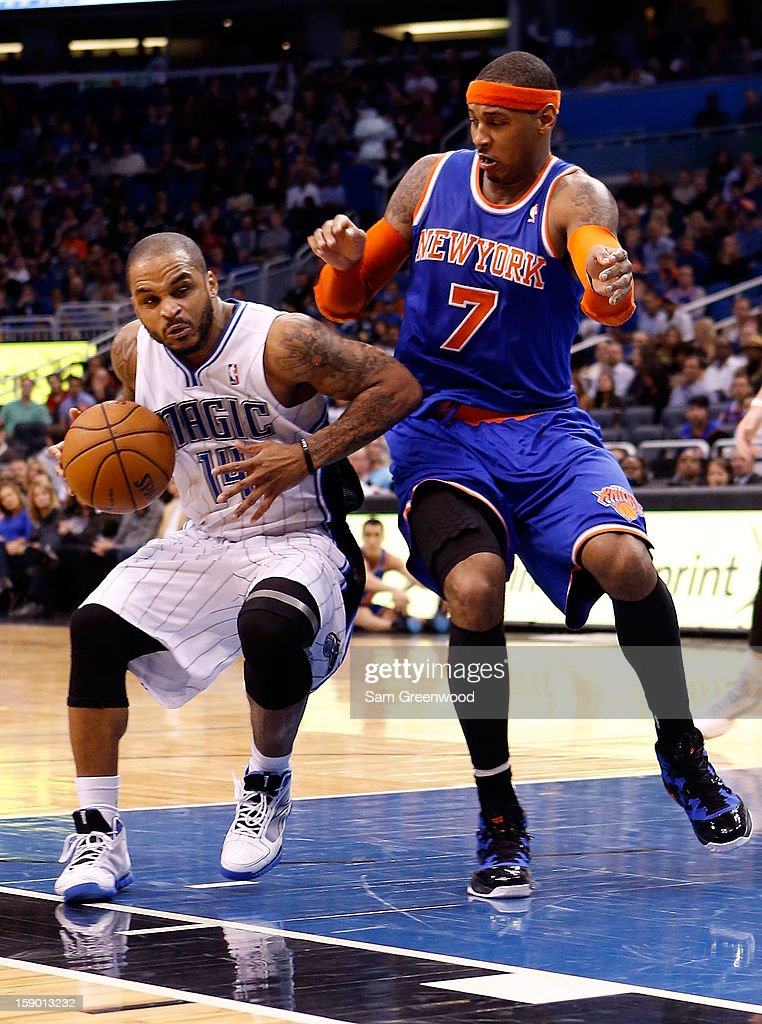 Jameer Nelson #14 of the Orlando Magic is gaurded by Carmelo Anthony #7 of the New York Knicks during the game at Amway Center on January 5, 2013 in Orlando, Florida.