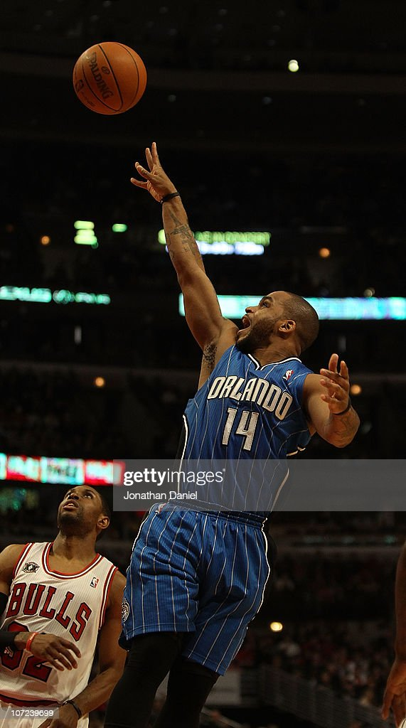 Jameer Nelson #14 of the Orlando Magic puts up a shot against the Chicago Bulls at the United Center on December 1, 2010 in Chicago, Illinois. The Magic defeated the Bulls 107-78.