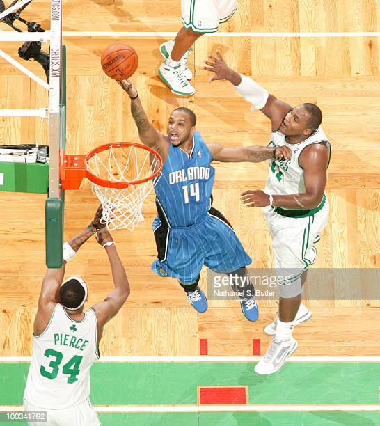 Jameer Nelson of the Orlando Magic shoots against Glen Davis of the Boston Celtics in Game Three of the Eastern Conference Finals during the 2010 NBA...