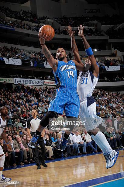 Jameer Nelson of the Orlando Magic shoots against Jason Terry of the Dallas Mavericks during a game on January 8 2011 at the American Airlines Center...