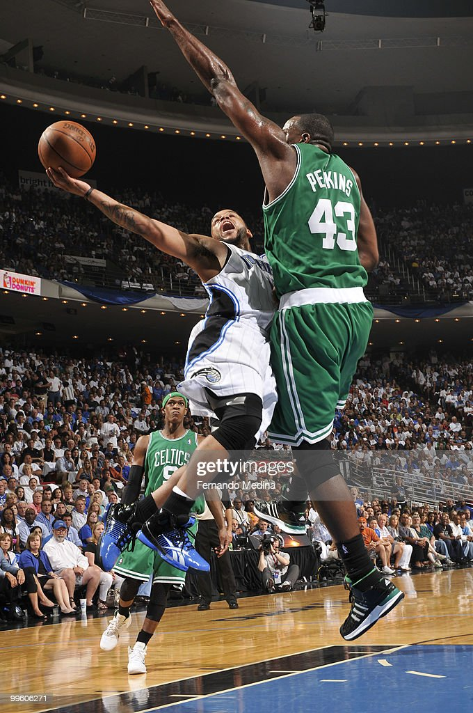 Jameer Nelson #14 of the Orlando Magic shoots against Kendrick Perkins #43 of the Boston Celtics in Game One of the Eastern Conference Finals during the 2010 NBA Playoffs on May 16, 2010 at Amway Arena in Orlando, Florida.