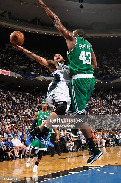 Jameer Nelson of the Orlando Magic shoots against Kendrick Perkins of the Boston Celtics in Game One of the Eastern Conference Finals during the 2010...