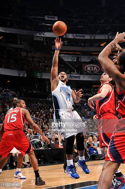 Jameer Nelson of the Orlando Magic shoots against Kirk Hinrich of the Atlanta Hawks in Game One of the Eastern Conference Quarterfinals in the 2011...