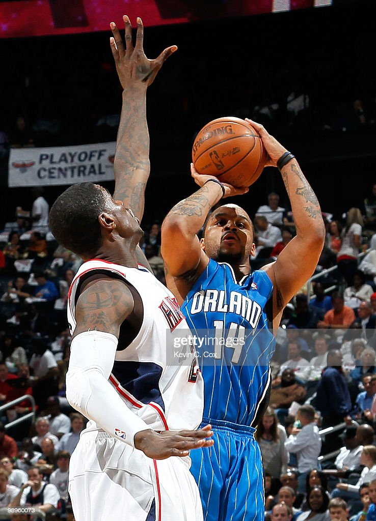 Jameer Nelson #14 of the Orlando Magic shoots over Marvin Williams #24 of the Atlanta Hawks during Game Four of the Eastern Conference Semifinals of the 2010 NBA Playoffs at Philips Arena on May 10, 2010 in Atlanta, Georgia.