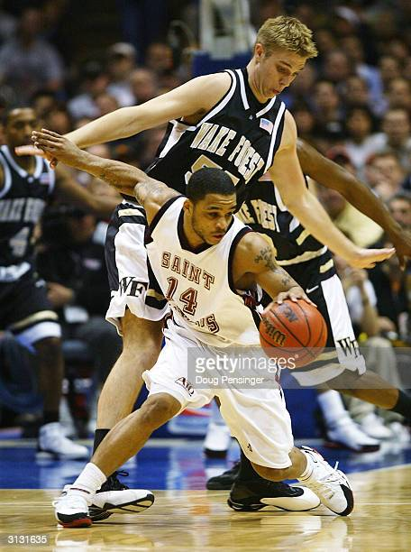 Jameer Nelson of the St Joseph's Hawks handles the ball as he is defended by Kyle Visser of the Wake Forest Demon Deacons during their third round...
