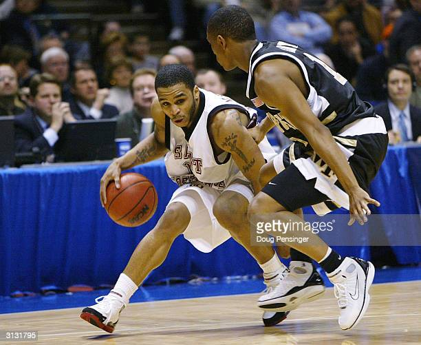 Jameer Nelson of the St Joseph's Hawks looks for an opening as he drives against Justin Gray of the Wake Forest Demon Deacons during their third...