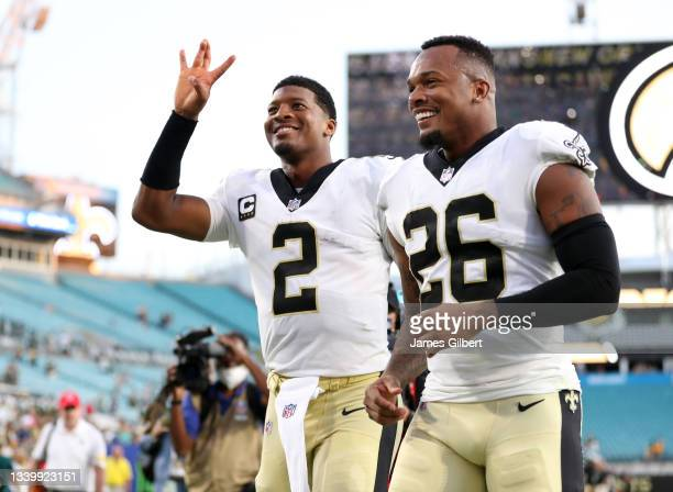 Jameis Winston and P.J. Williams of the New Orleans Saints celebrate after defeating the Green Bay Packers at TIAA Bank Field on September 12, 2021...