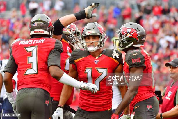 Jameis Winston celebrates with Justin Watson of the Tampa Bay Buccaneers after connecting for a touchdown during the second quarter of a football...
