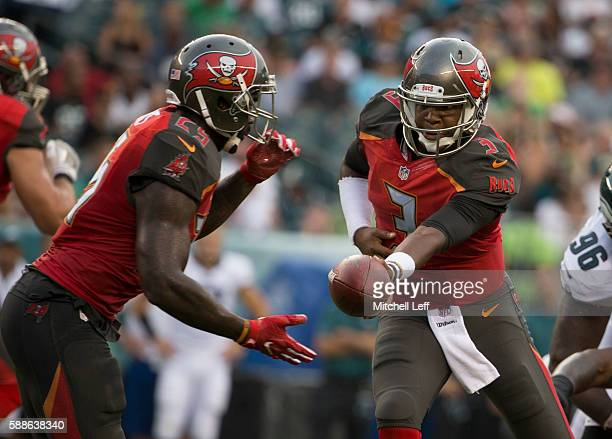 Jameis Winston hands the ball off to Mike James of the Tampa Bay Buccaneers in the first quarter against the Philadelphia Eagles at Lincoln Financial...
