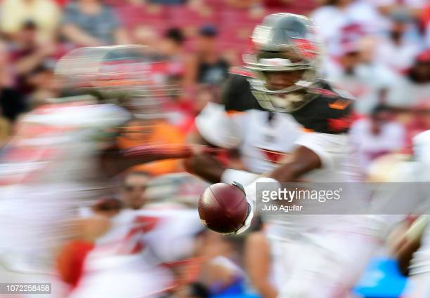 Jameis Winston hands the ball off to Peyton Barber of the Tampa Bay Buccaneers during the fourth quarter against the San Francisco 49ers at Raymond...