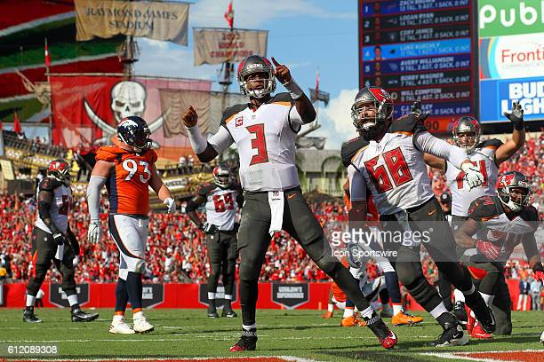 Jameis Winston of the Buccaneers dives into the end zone for the touchdown and then celebrates the score during the regular season game between the...
