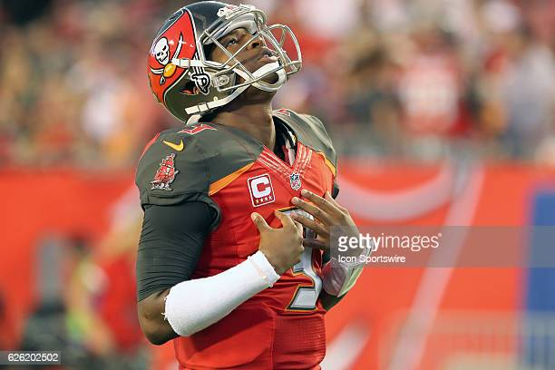 Jameis Winston of the Buccaneers looks up to the skies to thank God during the NFL Game between the Seattle Seahawks and Tampa Bay Buccaneers on...