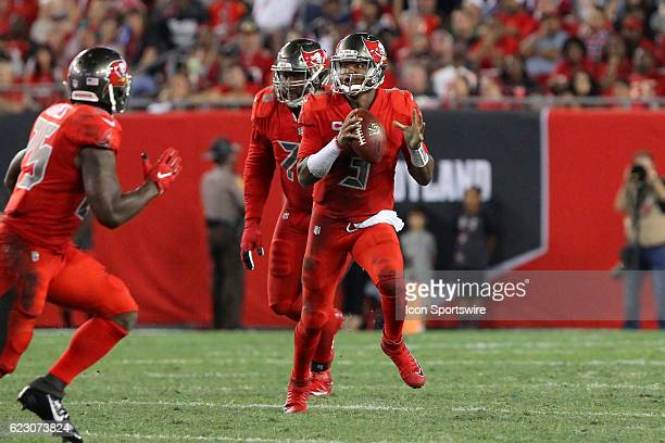 Jameis Winston of the Buccaneers rolls out to his left as he looks for an open receiver during the NFL game between the NFC South opponent Atlanta...
