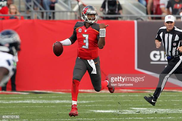 Jameis Winston of the Buccaneers uses his thumb to signal a receiver to move to the left during the NFL Game between the Seattle Seahawks and Tampa...