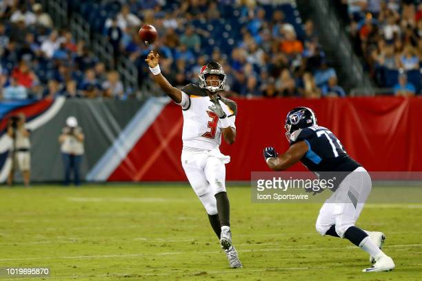 Jameis Winston of the Bucs gets a pass off during the preseason game between the Tennessee Titans and Tampa Bay Buccaneers on August 18 2018 at...