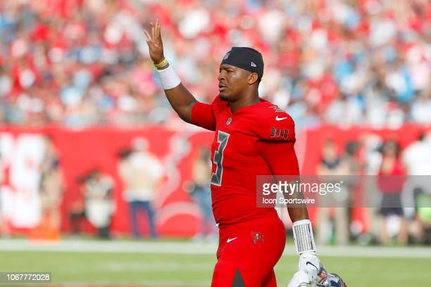 Jameis Winston of the Bucs holds up four fingers to signal that the Bucs are a fourth quarter team during the regular season game between the...
