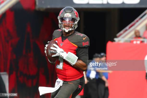 Jameis Winston of the Bucs looks for an open receiver during the regular season game between the Atlanta Falcons and the Tampa Bay Buccaneers on...