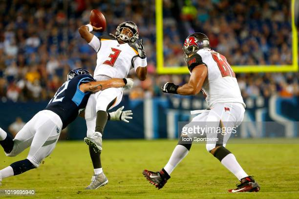 Jameis Winston of the Bucs scrambles around and is finally caught by a Titans defender but Winston is able to get the pass off to Chris Godwin of the...