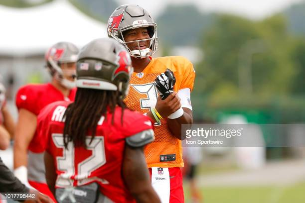 Jameis Winston of the Bucs signals a holding call against the defense during the joint training camp work out between the Tampa Bay Buccaneers and...