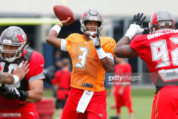Jameis Winston of the Bucs throws the ball during the joint training camp work out between the Tampa Bay Buccaneers and the Tennessee Titans on...