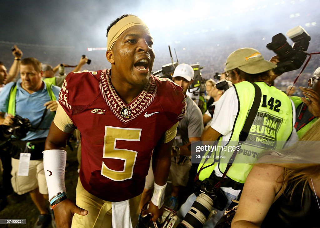 Jameis Winston #5 of the Florida State Seminoles celebrates after defeating the Notre Dame Fighting Irish 31-27 at Doak Campbell Stadium on October 18, 2014 in Tallahassee, Florida.