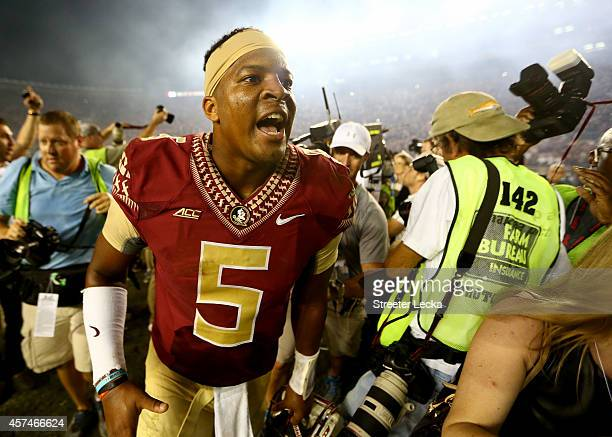 Jameis Winston of the Florida State Seminoles celebrates after defeating the Notre Dame Fighting Irish 3127 at Doak Campbell Stadium on October 18...