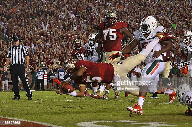 Jameis Winston of the Florida State Seminoles dives for the endzone during a game against the Miami Hurricanes at Doak Campbell Stadium on November 2...