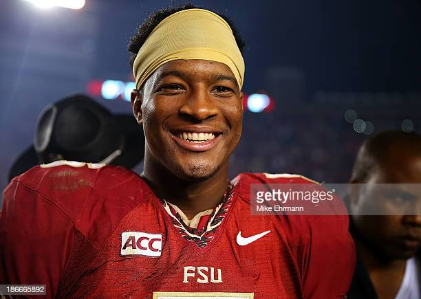 Jameis Winston of the Florida State Seminoles looks on during a game against the Miami Hurricanes at Doak Campbell Stadium on November 2 2013 in...