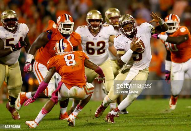 Jameis Winston of the Florida State Seminoles runs with the ball against Darius Robinson of the Clemson Tigers during their game at Memorial Stadium...