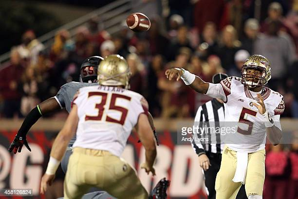 Jameis Winston of the Florida State Seminoles throws the ball in the first quarter against the Louisville Cardinals during their game at Papa John's...