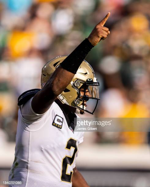 Jameis Winston of the New Orleans Saints celebrates after scoring a touchdown during the first half of a game against the Green Bay Packers at TIAA...