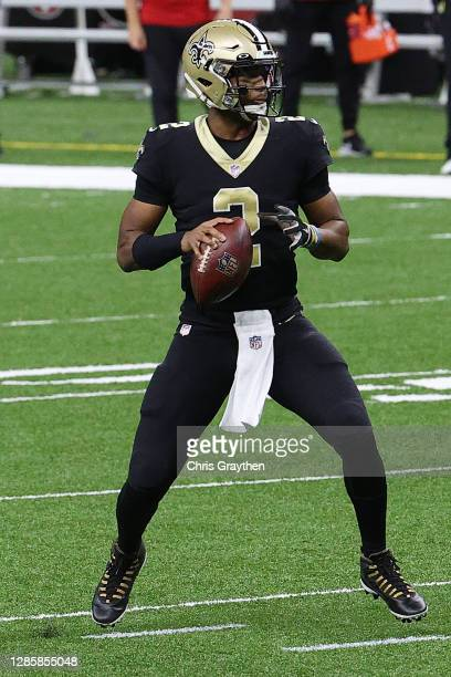 Jameis Winston of the New Orleans Saints looks to attempt a pass during their game against the San Francisco 49ers at Mercedes-Benz Superdome on...