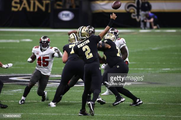 Jameis Winston of the New Orleans Saints throws a pass against the Tampa Bay Buccaneers during the second quarter in the NFC Divisional Playoff game...