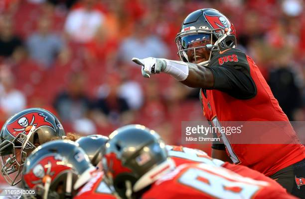 Jameis Winston of the Tampa Bay Buccaneers calls a play during a preseason game against the Cleveland Browns at Raymond James Stadium on August 23...