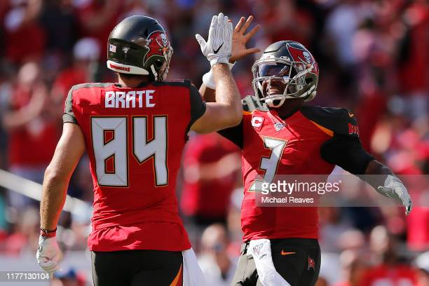 Jameis Winston of the Tampa Bay Buccaneers celebrates with Cameron Brate after a touchdown against the New York Giants during the first quarter at...